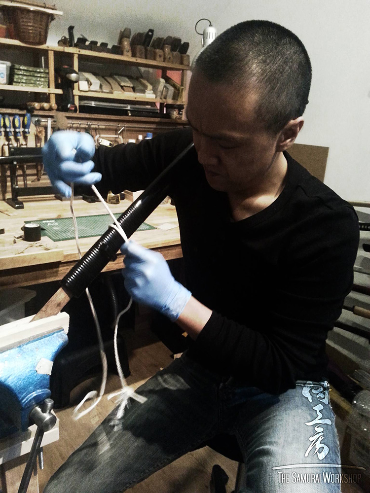 Jeffrey carefully polishing the grooves between the individual 'strands' of rattan
